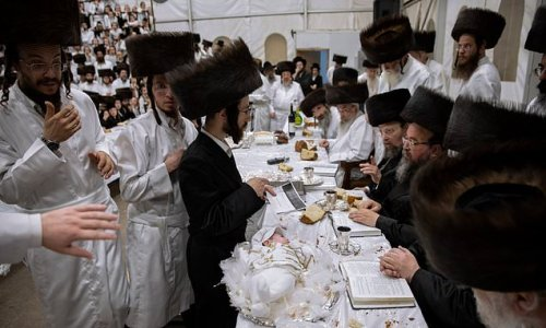 First-born great-grandson of Orthodox Rabbi is presented on platter