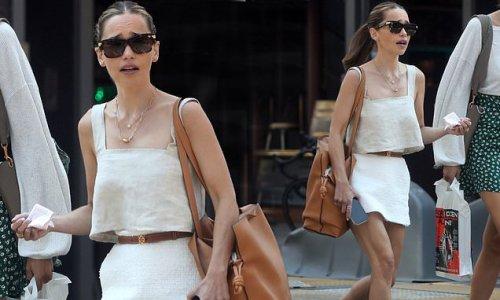 Emilia Clarke showcases toned legs in mini skirt and beige crop top