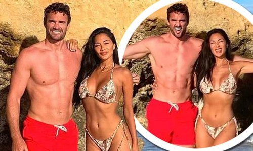 Nicole Scherzinger shows off her incredible physique with Thom Evans