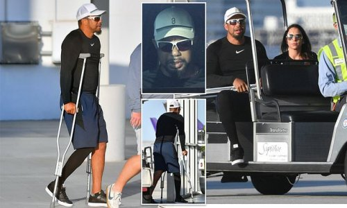 Tiger Woods seen hobbling on crutches four months after car crash