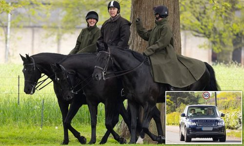 Prince Andrew smiles as he enjoys a horse ride with two grooms
