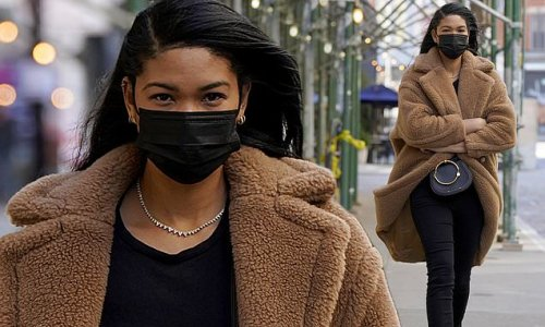 Chanel Iman wraps up in a beige coat while on a walk in cold NYC