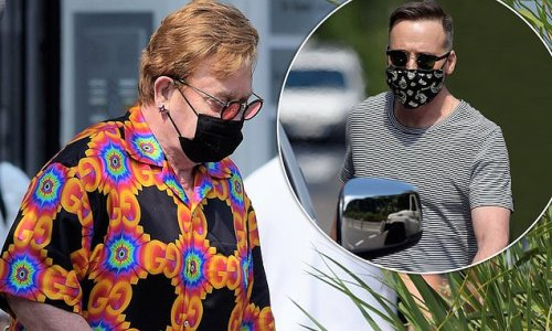 Elton John, 74, catches the eye in a brightly patterned Gucci shirt