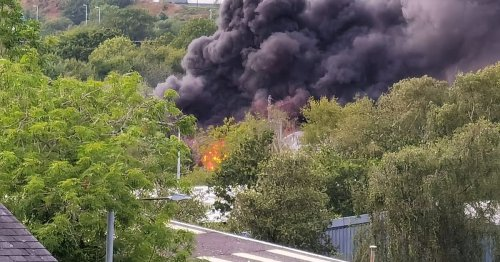 Huge clouds of black smoke seen billowing from industrial estate - live updates