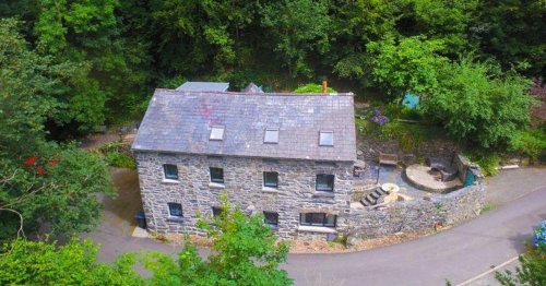 Inside 18th-century former water mill on outskirts of Snowdonia that's for sale