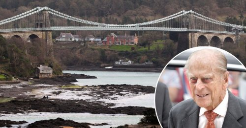 Prince Philip stopped and offered to help change flat tyre on family's car during trip to Anglesey