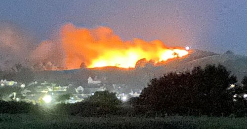 Massive fire engulfs hill as flames climb hundreds of feet in the air