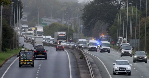 A55 lorry driver taken to hospital after HGV tips over