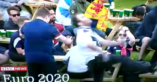 Moment frustrated Scotland fan aims kick at Fan Zone table- and misses