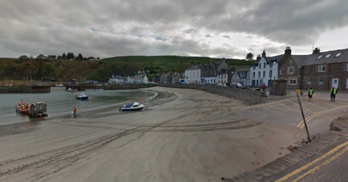 Man charged with 'number of road offences' after car gets stuck on Scots beach