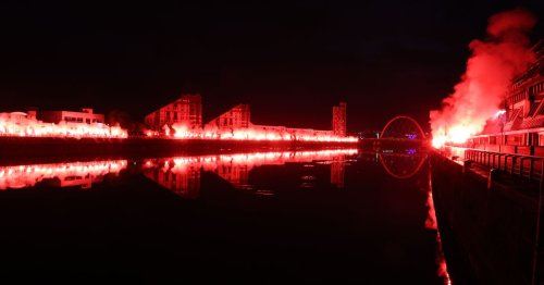 Rangers fans let off hundreds of red flares over the River Clyde