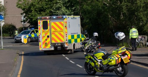 Cyclist hospitalised after crash with motorbike as cops close Edinburgh road