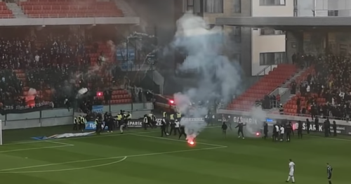 Slovakia derby abandoned as hooligans storm pitch and throw flares at each other