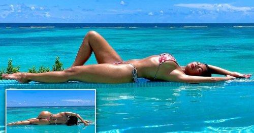 Nicole Scherzinger parades killer curves as she poses in pool on lavish trip