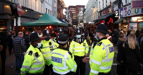 Boozy brits pack out pubs as fight breaks out 'over tabes' on first Friday out