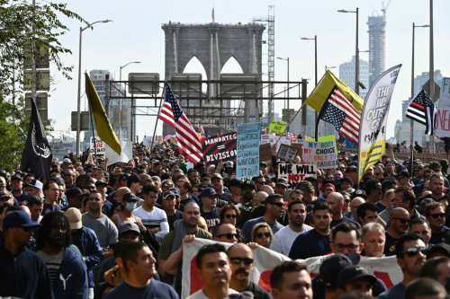 NYC Firefighters And Police Officers Join Thousands In Brooklyn Bridge March Against City Vaccine Mandate