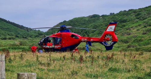 Woman airlifted to hospital after hitting head on rocks