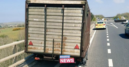 Trailer hits barrier after coming loose on A30