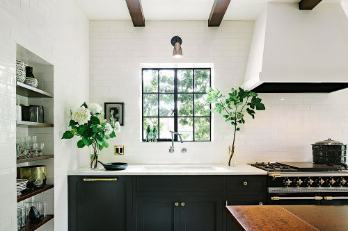Black Kitchen Cabinets Instantly Make Dated Features Cooler