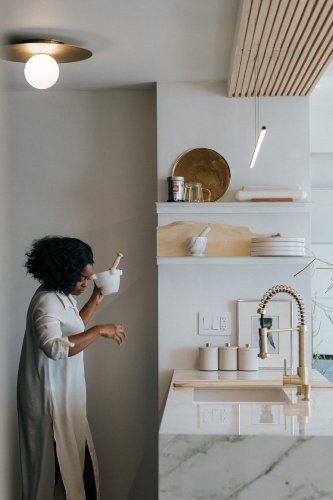 A Designer Made Up for Lost Storage By Ditching a Wall in Her Tiny Kitchen