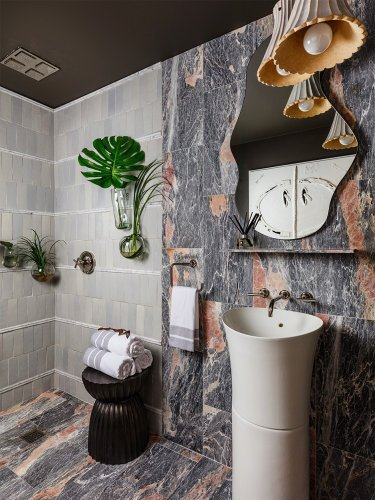 A Rainforest-Inspired Powder Room That Re-creates Showering Outdoors Inside