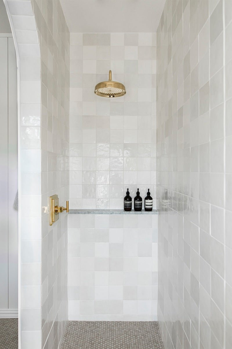 Renovators are moving away from this shower-floor material