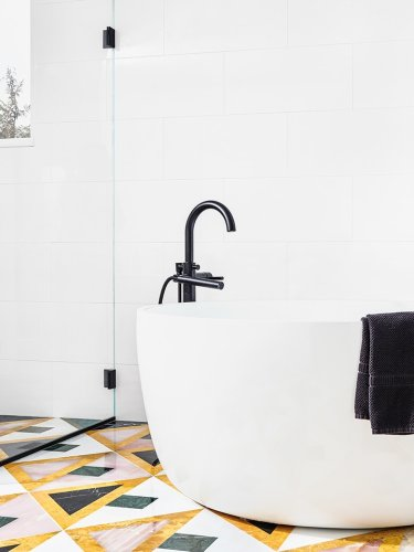 Textile Designer Aelfie Oudghiri Recreated a Rug Design in Stone on Her Bathroom Floor