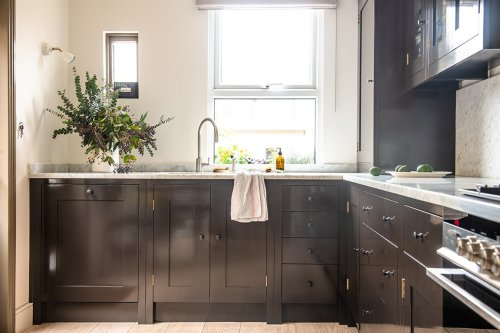 First Came Natural Wood—Now Painted Brown Cabinets Are Getting Their Moment
