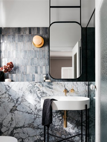 Think Gray Tile Bathrooms Are Dull? Tell That to These 8 Spaces