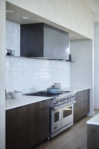 """7 Dark Brown Kitchen Cabinets That Don't Scream """"Dated Cabin Cherry"""""""