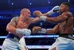 Usyk boxt Joshua vom Schwergewichts-Thron – Sieg nach Punkten