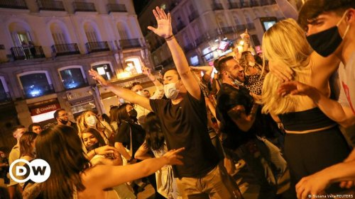 Spain celebrates end of COVID lockdown with street parties