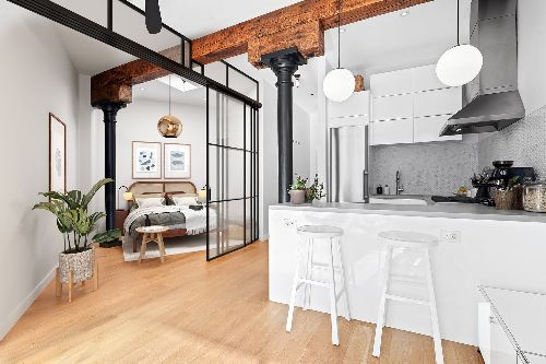 Cast Iron Pillars Bring Gravitas to an Airy NYC Studio Listed for $925K