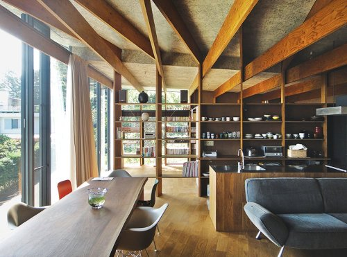 Articles about japanese home among trees uses bookshelves and glass walls on Dwell.com