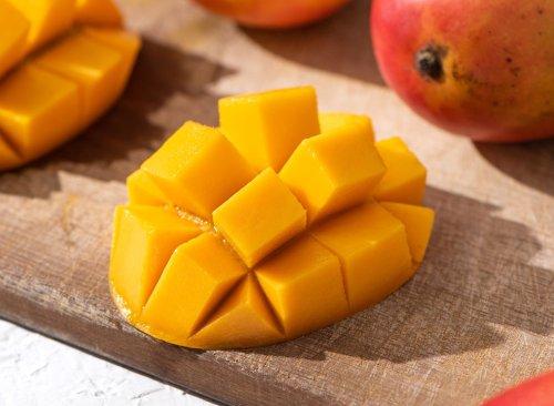 Secret Side Effects of Eating Mango, Says Dietitian
