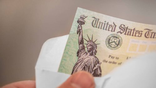 How are Americans using their $1,400 stimulus checks? Here's what a survey found