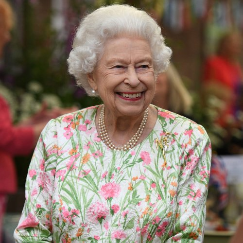 See Queen Elizabeth II Happily Wield a Sword to Cut Cake at G7 Summit Event