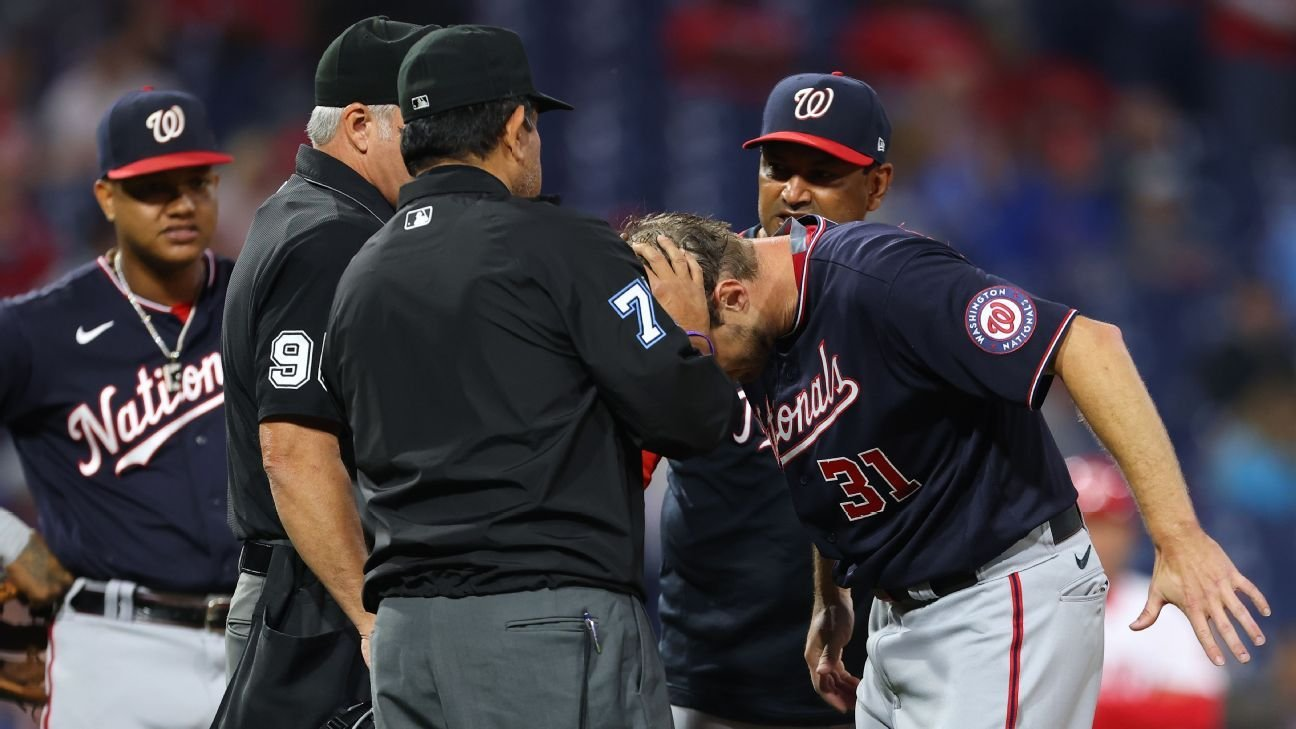 Washington Nationals GM Mike Rizzo calls Philadelphia Phillies' Joe Girardi 'a con artist' after spat with Max Scherzer