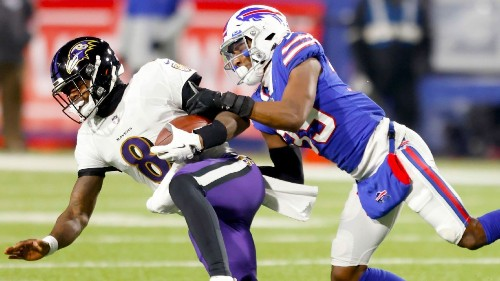 John Harbaugh defends Baltimore Ravens' run-heavy offense