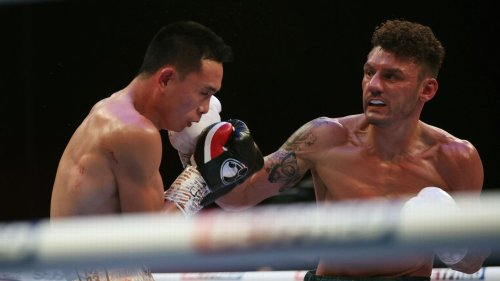 Wood shocks Can, takes title in 12th-round TKO