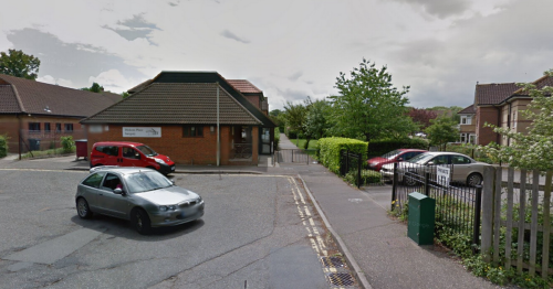 Police tape off alleyway near supermarket after woman raped