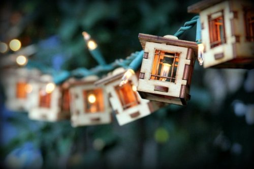 25% off a set of string lights with craftsman style bungalows