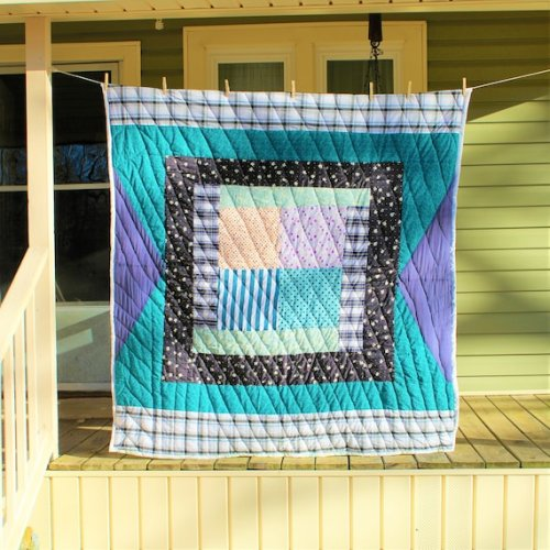 Handcrafted blue and purple quilt