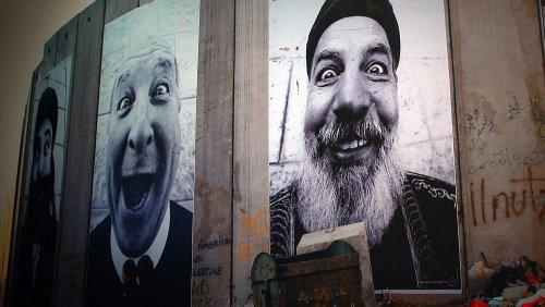 Artista francês JR questiona estereótipos entre israelitas e palestinianos
