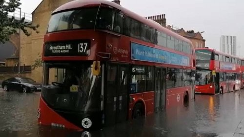 Cars and buses stuck as London roads flood in storm