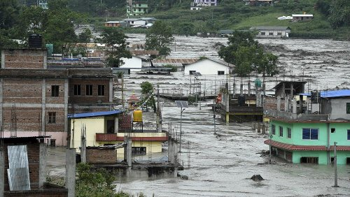 Rescuers at deadly Nepal flood as waters swirl through houses