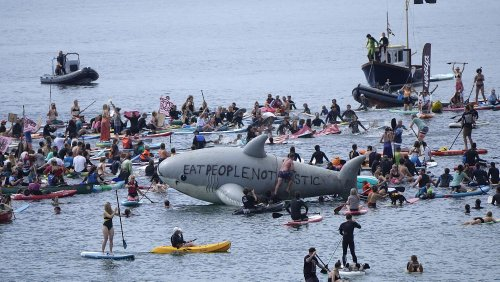 Climate change activists stage G7 protest on Cornwall beach