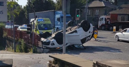 Man crawls out of Range Rover after flipping it onto its roof in crash