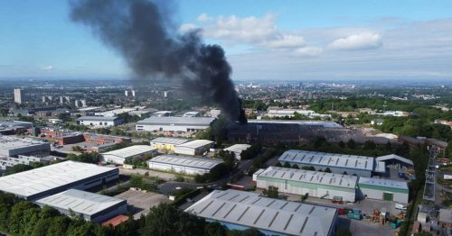 Live as thick black smoke billows across Leeds after huge factory fire