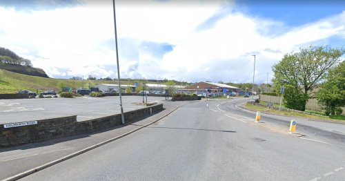 Live as Huddersfield road closed after man knocked down and critical